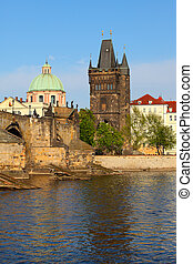 Charles Bridge over Vltava river and Old town in Prague