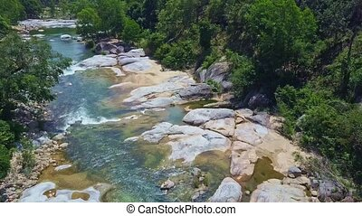 Aerial View River with Clean Fresh Water and Rocky Banks -...
