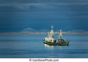 Shrimp boat on the North Sea, Germany.