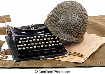 US military helmet of the Second World War with old typewriter