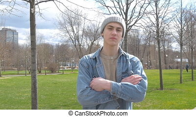 A young man looks haughtily at the camera. The informal is...