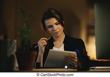 Woman thinking about new design - Young serious woman...