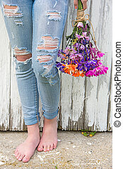 barefoot teen girl in frayed jeans