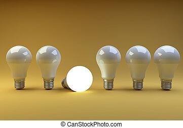 Row of LED light bulbs with one different from the others on a orange background.