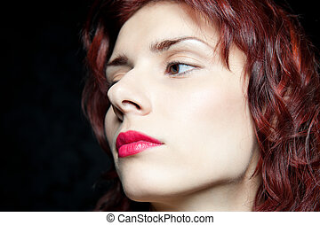 Head of beautiful woman with red hair