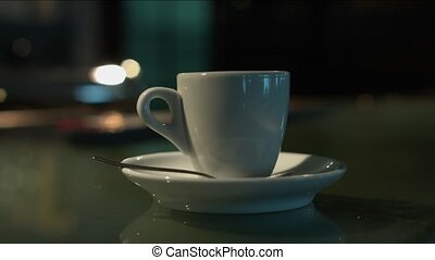 Woman's hand takes a Cup of coffee. Close-up