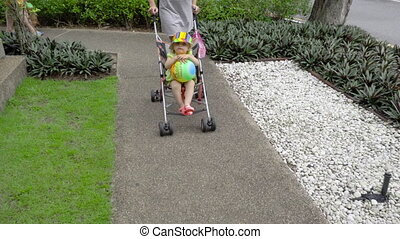 Woman walking with child in park of hotel