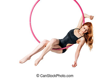 Slim girl in an airy ring with red hair on a white...