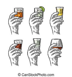 Hand holding glass with tequila, vodka, rum, cognac, whiskey, gin.