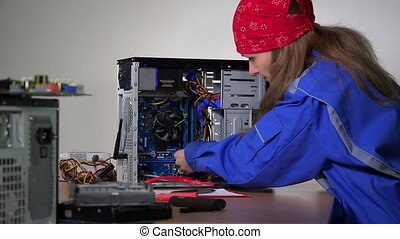 computer service specialist woman remove and examine ram...