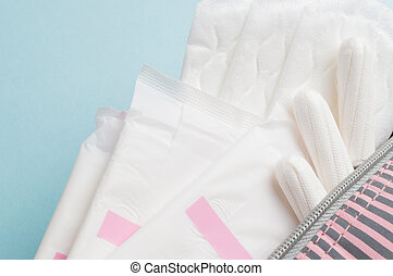 Menstrual tampons and pads in cosmetic bag. Menstruation...