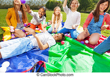 Group of happy kids having fun playing with balls