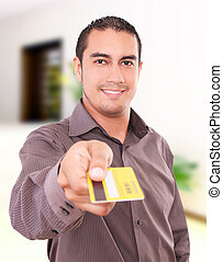 Man buying - Young man smiling and giving his credit card