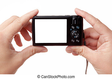 Hands holding digital photo camera