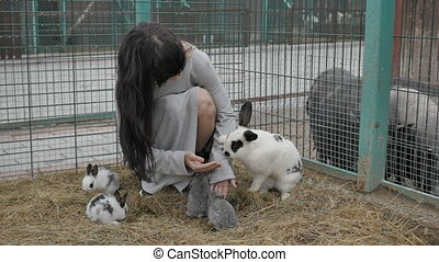 Woman giving food to bunnies