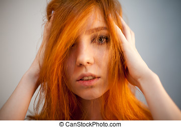 Portrait of redhead woman in soft focus