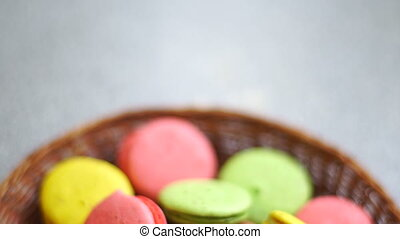 colored cookies in the wicker plate close up