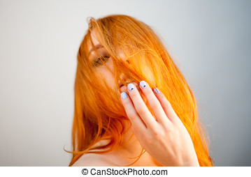 Attractive dreammy portrait of redhead woman in soft focus