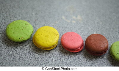 colored macaroon cookie disappears from the table - close up...