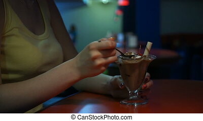 footage woman sitting in a cafe and eat ice cream.