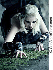 Gothic woman creep on the floor