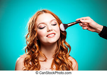 Master inflicts brush powder on the face of the girl -...