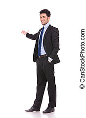 full body picture of a businessman presenting on white...