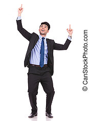 excited businessman pointing fingers and looking up - full...