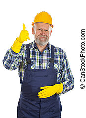 Elderly plumber showing thumbs up - Picture of an elderly...