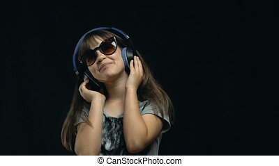 Young Cute Girl Dancing with Headphones