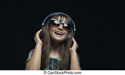 Young Cute Girl with Headphones and Sunglasses