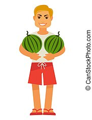 Smiling male person holds two watermelons full length...