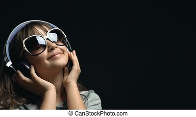 Young Cute Girl with Headphones and Sunglasses - Studio shot...
