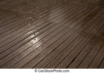 Texture of a wooden wet floor in the rain