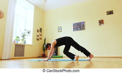 Man is engaged in yoga - In room on floor man doing yoga