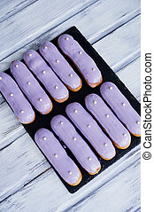 Eclairs, filled with purple frosting. A work of culinary art