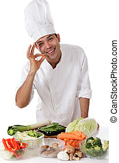 Young nepalese man chef, fresh vegetables