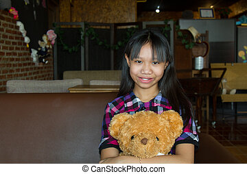 Girl hug teddy bear