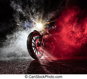 High power motorcycle chopper at night. Smoke on background.