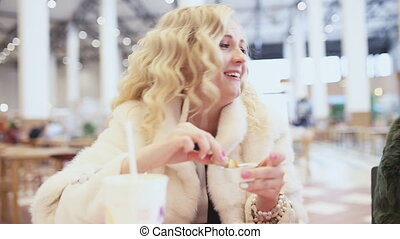 woman eating chicken fast food and laughing - Girl eating...