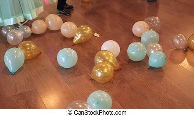 Colorful balloons on the floor. Children's holiday.