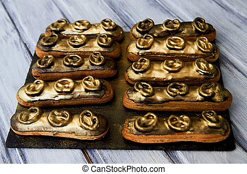 Eclairs, filled with Golden glaze.a work of culinary art