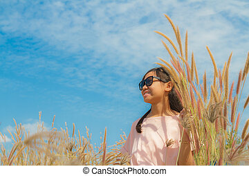 Girl and Feather pennisetum - Asia girl smile and Feather...