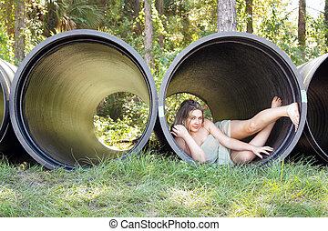 Beautiful Teen Girl in a Large Pipe