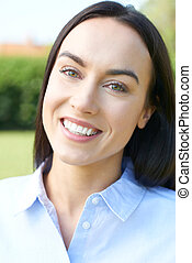 Outdoor Portrait Of Woman With Perfect Teeth And Beautiful Smile