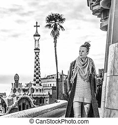 tourist woman at Guell Park in Barcelona having walking tour...