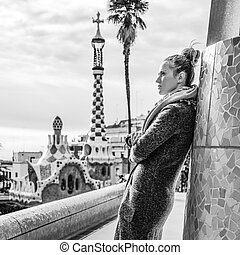 modern tourist woman standing at Guell Park, Spain in winter...