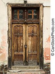 Ancient door - Ancient wooden door on the building