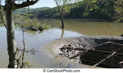 Old Drainage System In A Lake - A drainage system recycles...