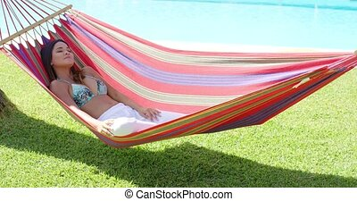 Calm young woman in hammock - Single calm young woman in...